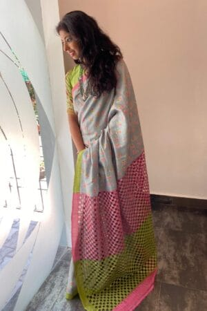 gey with pink and green cutwork pallu