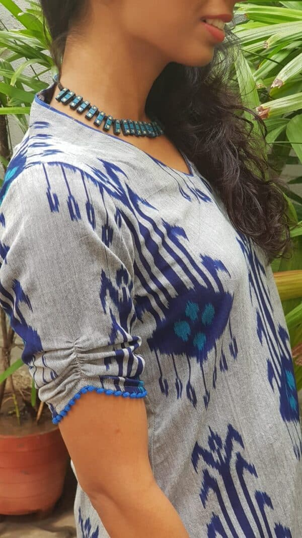 grey ikat top with white pants1