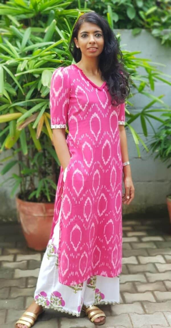 pink ikat top with white floral pants