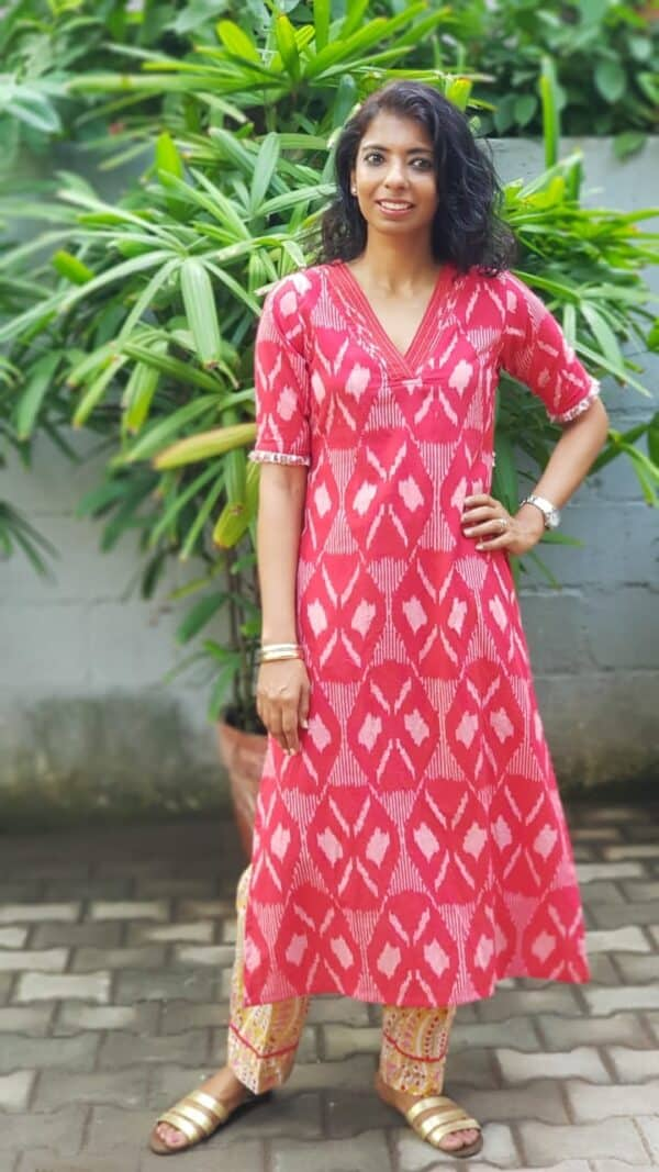 red ikat top with yellow pants