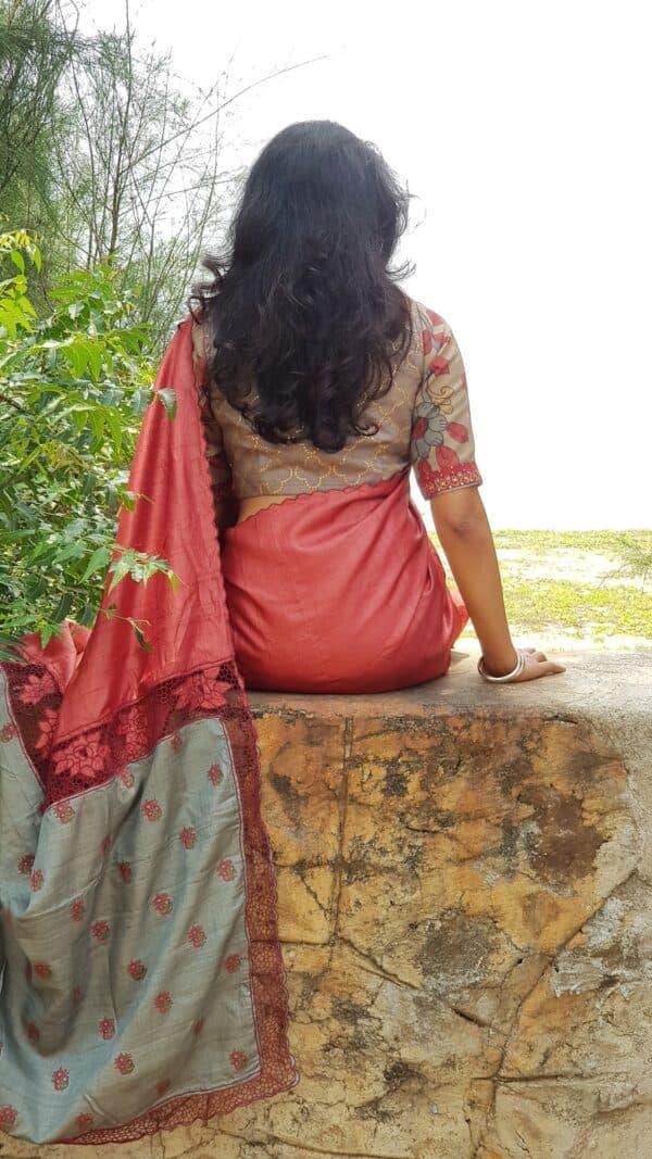 red with grey pallu