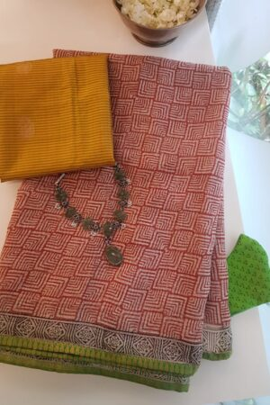 kota saree with block print and green silk border