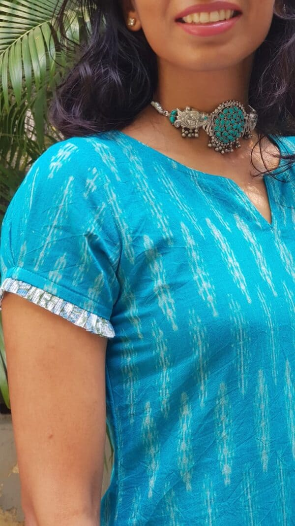 turquoise blue ikat top with white crochet pants2