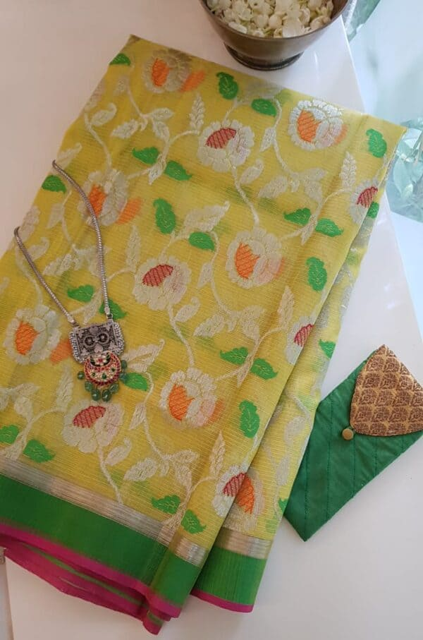 yellow with silver zari and meena work