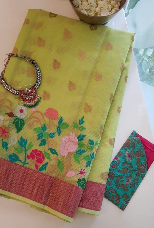 yellow with silver zari butta and meena border