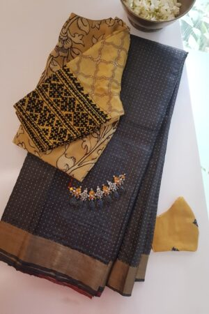 black tussar saree with zari border