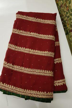 maroon georgette saree with beige kutch work