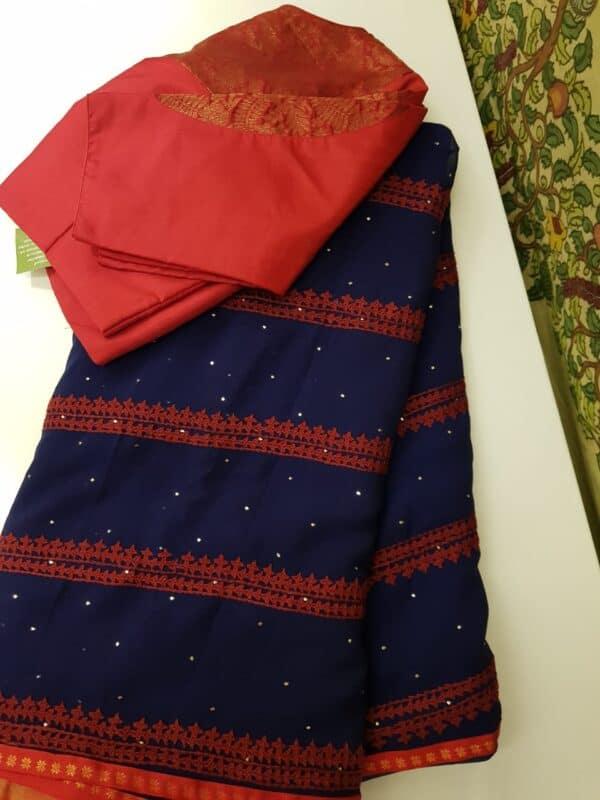 navy blue georgette saree with kutch worl
