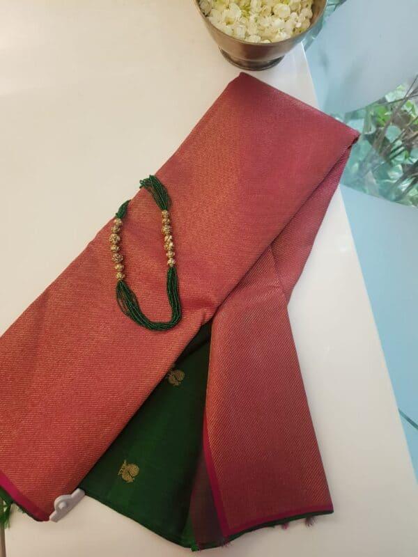 pink and bottle green shoulder design silk saree