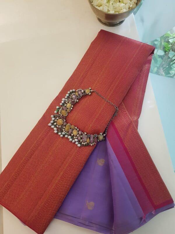 purple and pink shoulder design saree