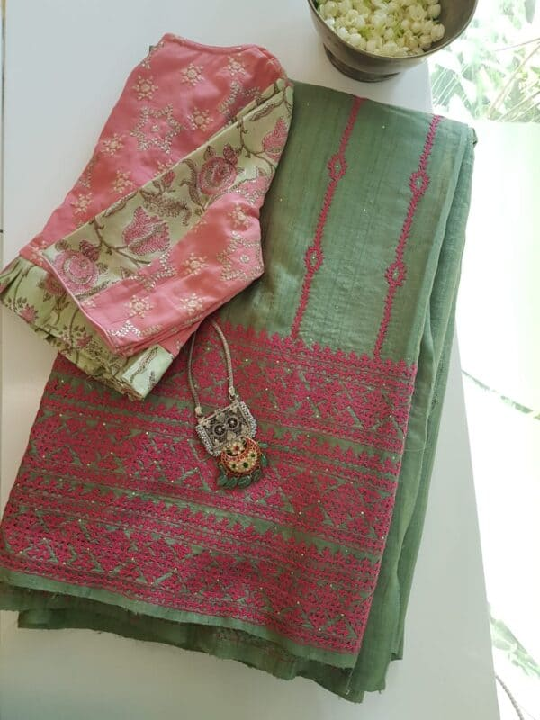 russian green tussar saree with pink kutch work