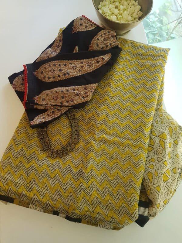 yellow, beige and black half half kota saree with silk pallu