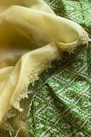 yellow orgnaza saree with green tussar pallu and cutwork