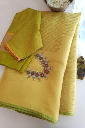 yellow rain drops with beige pallu