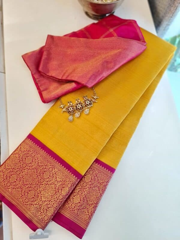 yellow with pink korvai border