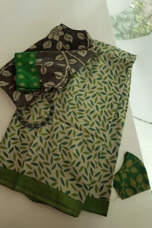 beige tussar saree with blue green prints