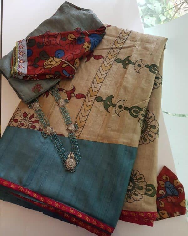 blue and beige kalamkari saree