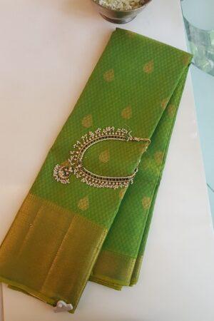 green kanchipuram silk saree with thread jacquard and morning evening border