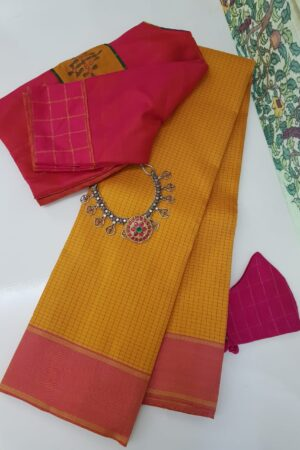 mustard with pink border and checks on the body