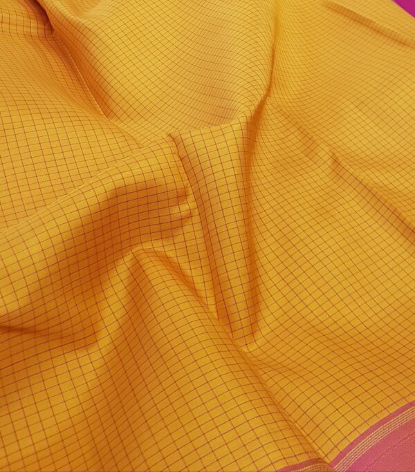 mustard with pink border and checks on the body1