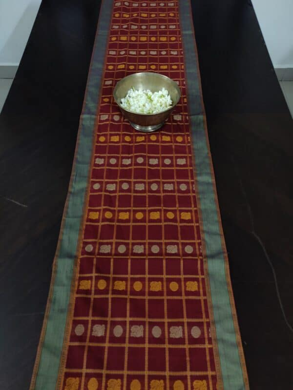 red table runner with mayil chakram motifs2