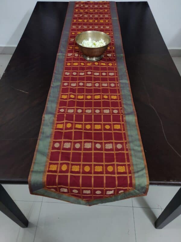 red table runner with mayil chakram motifs1