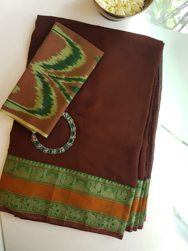 brown with green and rust kanchi cotton border on chiffon saree