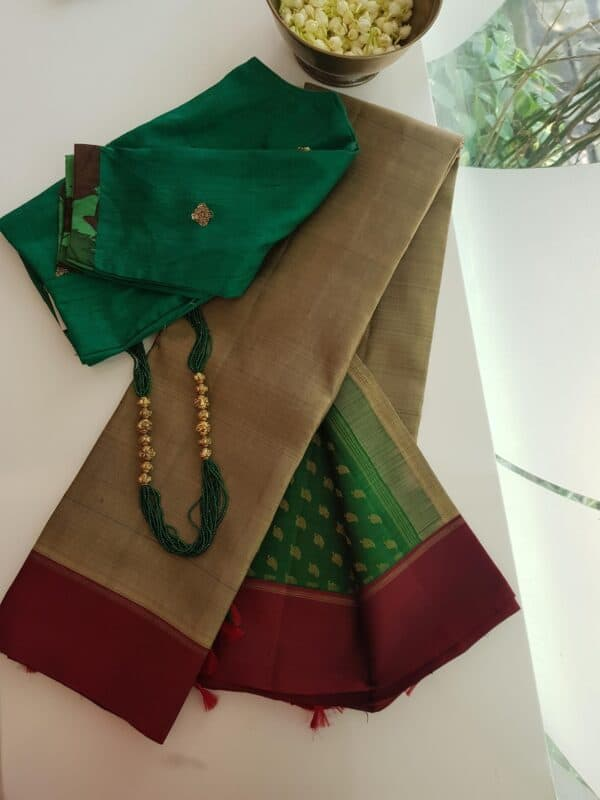 dark beige with bottle green pallu