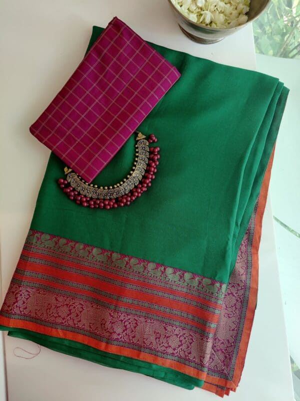 green chiffon saree with kanchi cotton border
