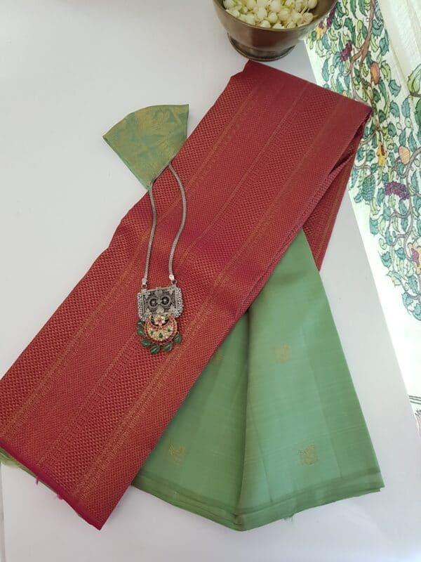 mint green and pink shoulder silk saree