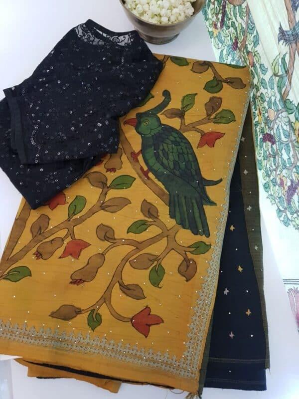 mustard with black pallu and kutch work