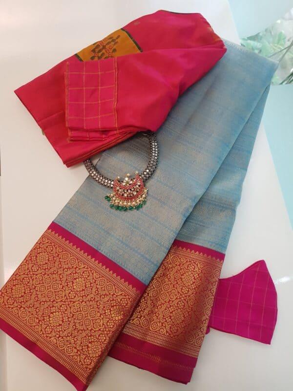 pastel blue with rani pink korvai border kanchi silk saree