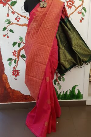 rani pink and bottle green risng saree