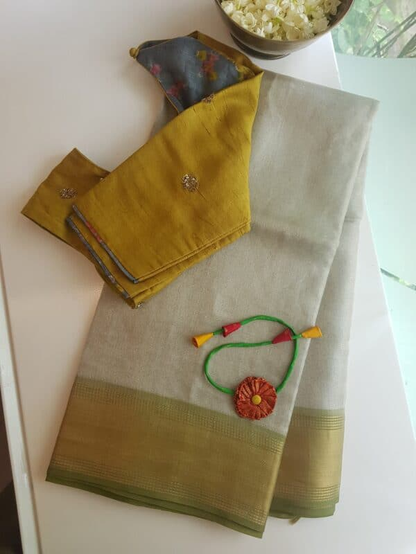 silver with olive green tissue tussar saree