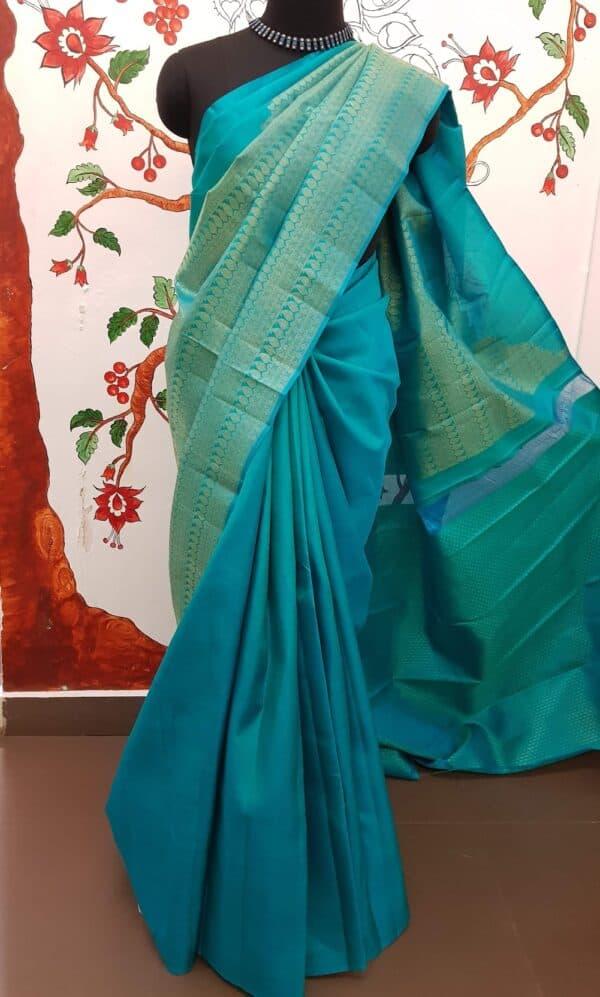 teal green half rising kanchi silk saree