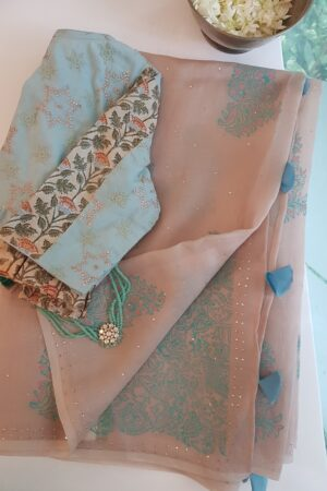 beige organza saree with block print and mukaish work