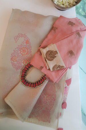 beige organza saree with peach and mukaish work