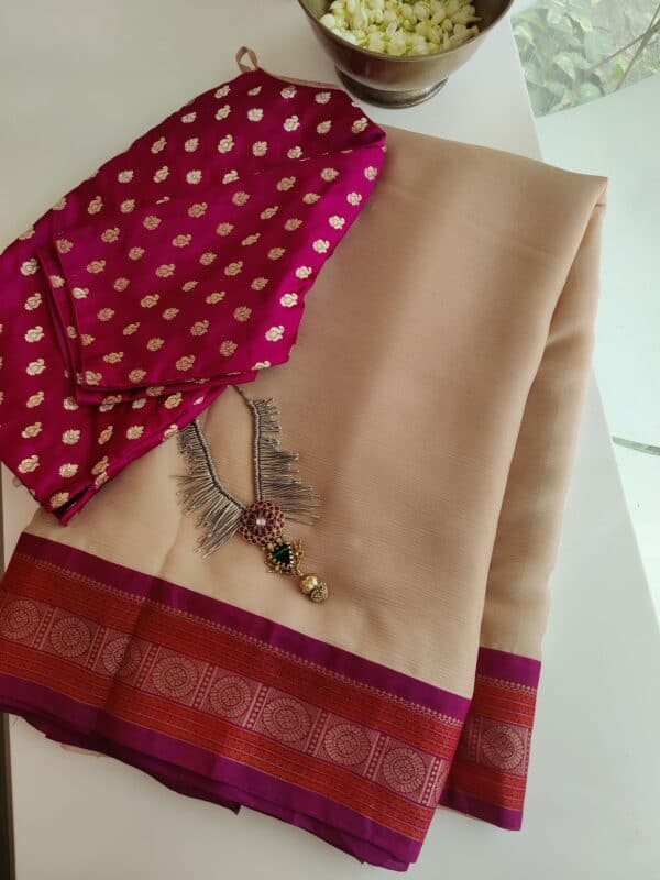 cream chiffon saree with majenta border