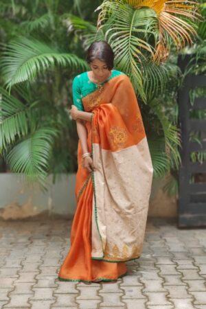 orange organza saree with block print and kutch work