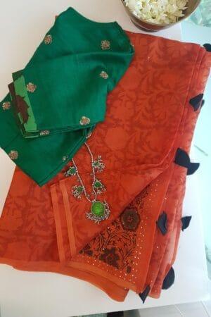 orange organza saree with mukaish work and block prints