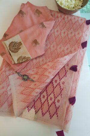 peach saree with block print and dark pink pallu