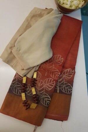 rust shaded tussar saree with prints