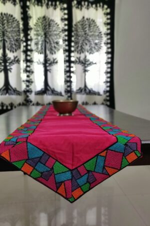 Pink kanchi cotton table runner with embroidered border