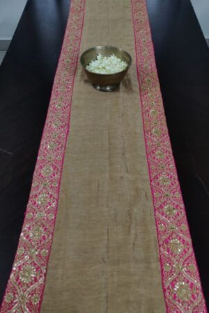 Beige table runner with embroidered border