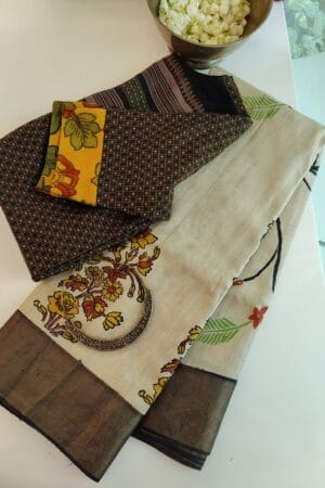 beige tussar saree with block print and hand paint