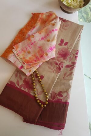 beige with pink zari border