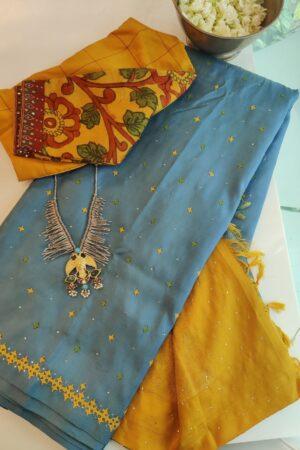 grey and yellow kutch work saree