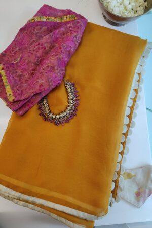 mustard chiffon saree with cream silk border