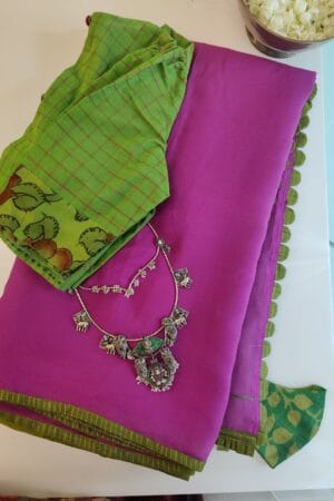 pink chiffon saree with green silk border