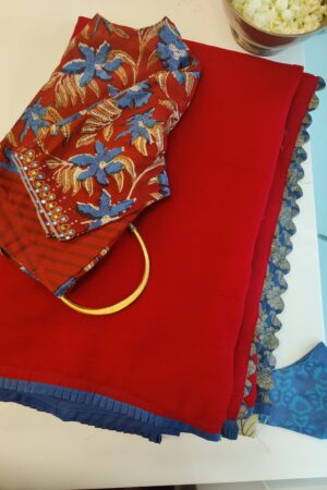 red chiffon saree with blue silk border